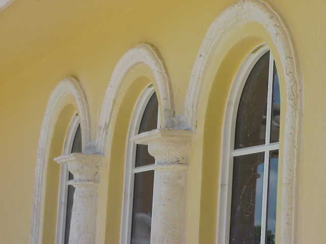 Cast Coral Stone Window Sills Designed and Installed by Stoneman, Inc.